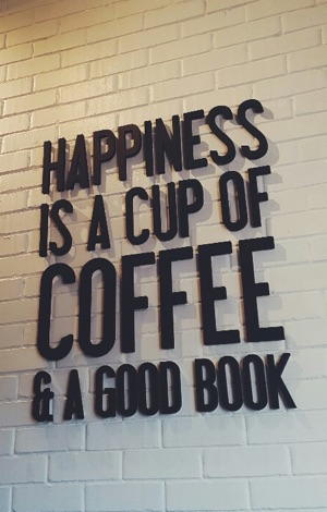 Display saying: Happiness is a cup of coffee and a good book